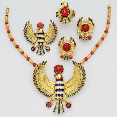 Coral, Enamel and 18K Gold Suite Including a necklace suspending a phoenix eagle with blue and white enamel body, and plique-a-jour enamel feathers, further decorated with three coral shen symbols